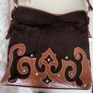 cowhide and soft leather shoulder bag.